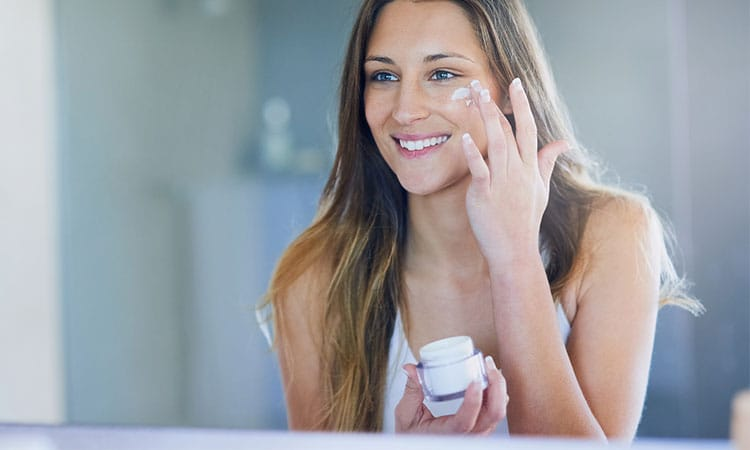 Woman-Applying-Face-Cream-in-the-Mirror-1.jpg